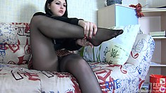 Busty Isidore A strips down to just her stockings and masturbates